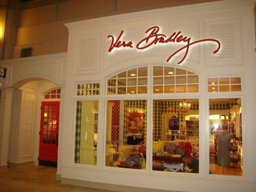 There are Vera Bradley stores which sell their purses. Also there are Vera Bradley outlet stores. Other than that, most of the physical stores that sell their purses are small independent boutiques.