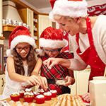Family preparing christmas gingerbread in the kitchen
